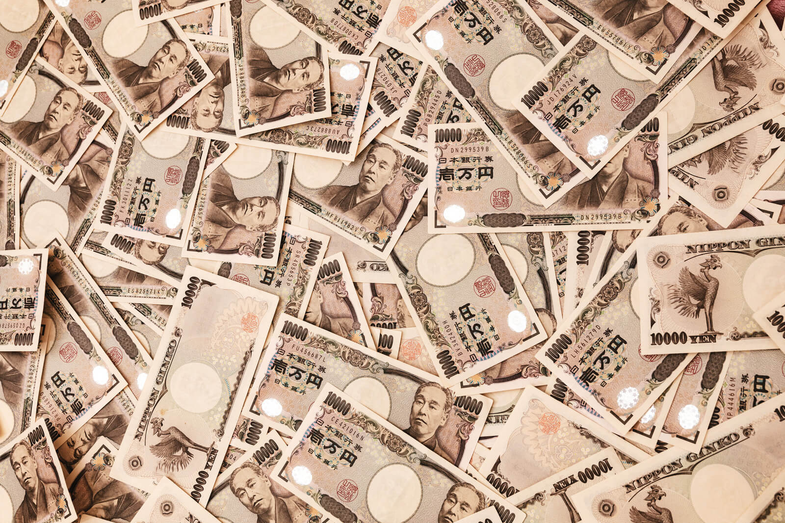 一万円札がばらまかれた画像